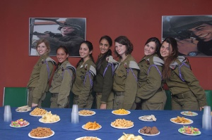 IDF recruits and hyper-masculinised posters Credit: http://www.flickr.com/photos/idfonline/6476614247